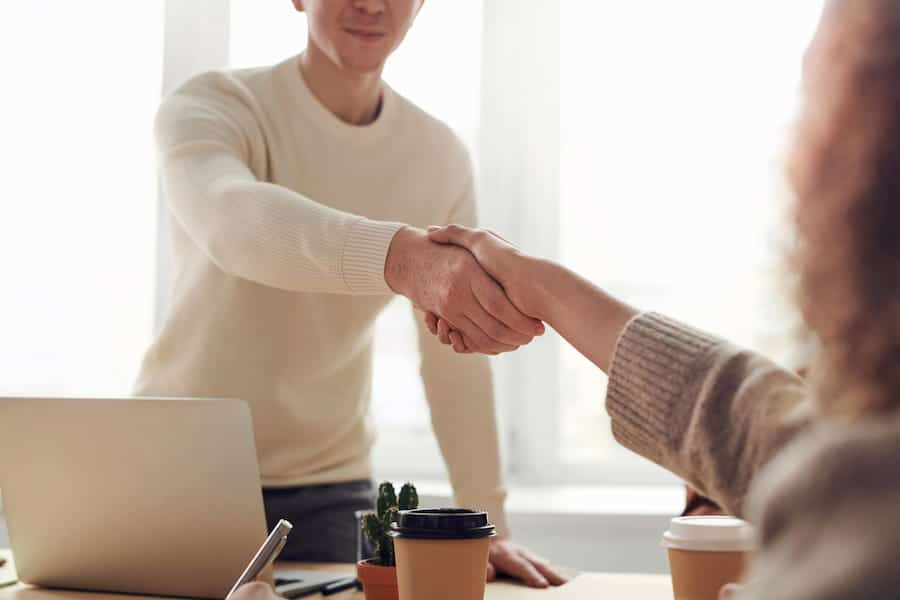 SHAKE HANDS GETTING A JOB OFFER TO APPLY FOR PERMANENT RESIDENCE UNDER RURAL AND NORTHERN IMMIGRATION PILOT