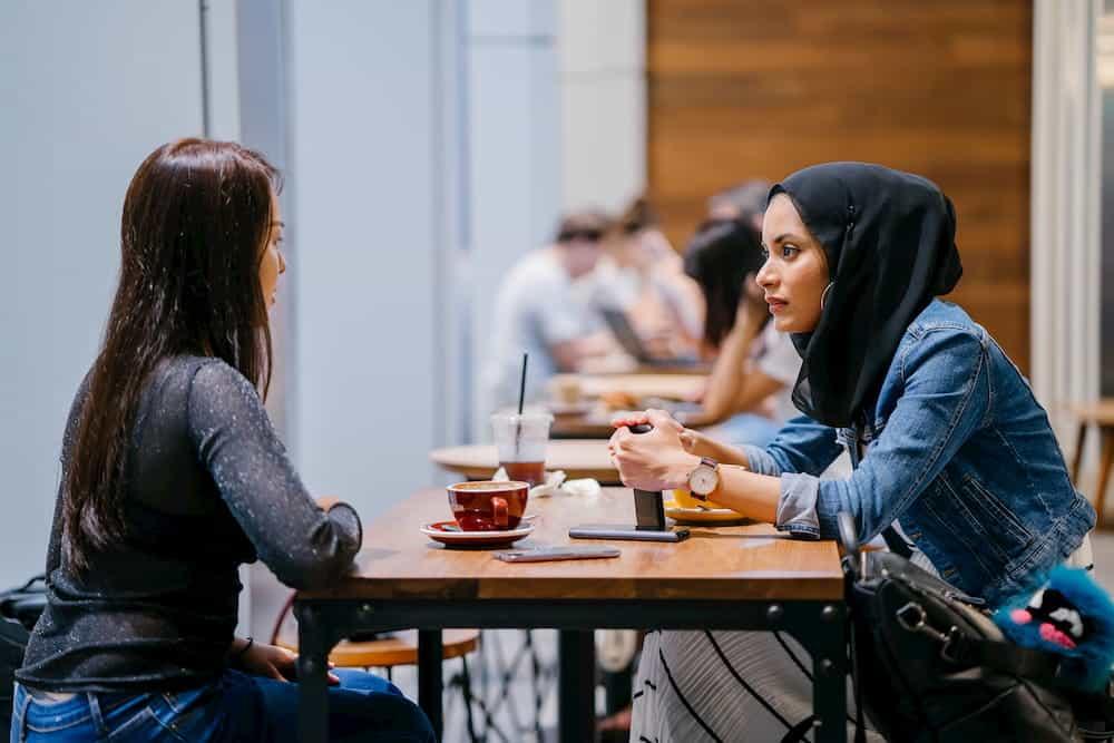 person talking to a muslim representing canada's public opinion on muslim presence